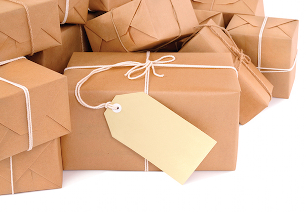 Untidy pile of brown parcels with label