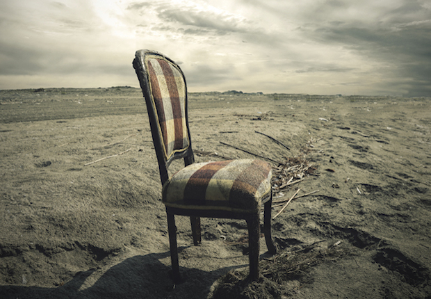 Wooden chair alone on Sand