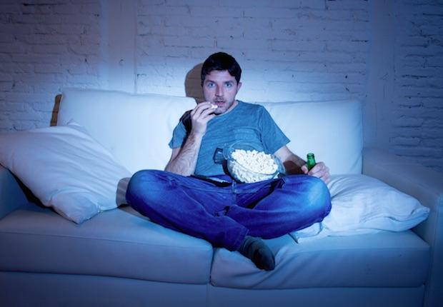 TV Night Popcorn Sofa iStock/OcusFocus