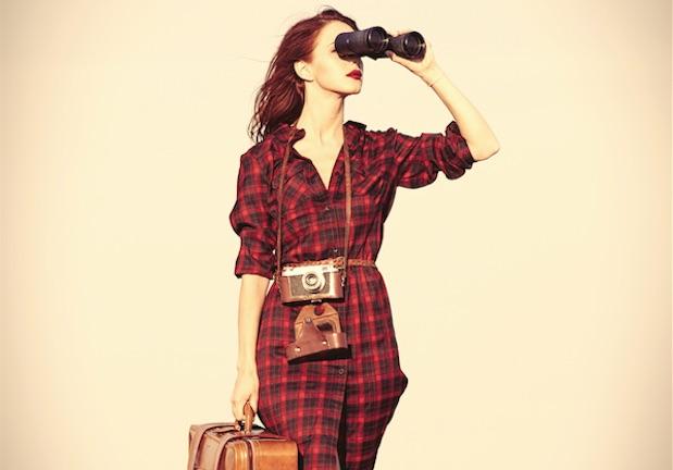 woman-holding-binocolars