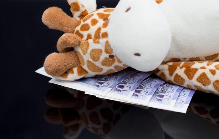 Child Toy Money iStock MinnaRossi