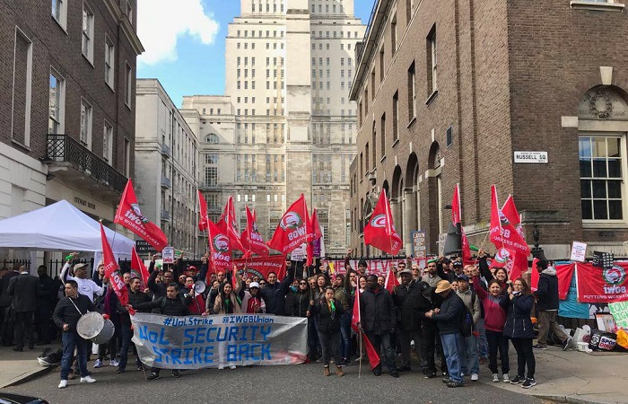 Outsourced staff strike for living wage and equal employment rights