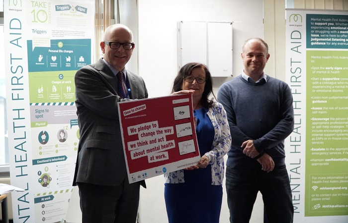 Tim Tozer, CEO, signs the Time to Change Employer Pledge