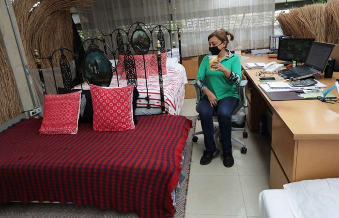 Colombian factory opens bedrooms for employees to live in after reopening
