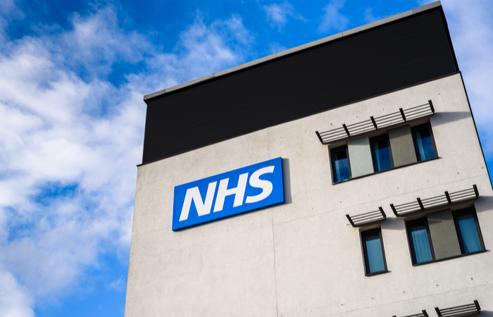 Two NHS trusts give 34,000 staff early access to pay