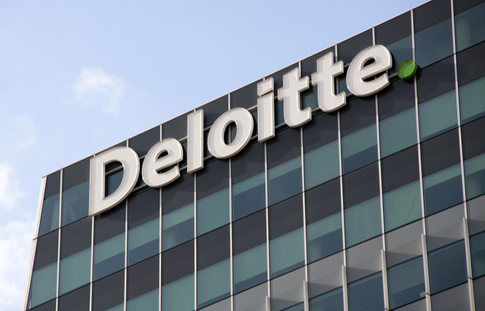 Deloitte reduces partner pay by 17%